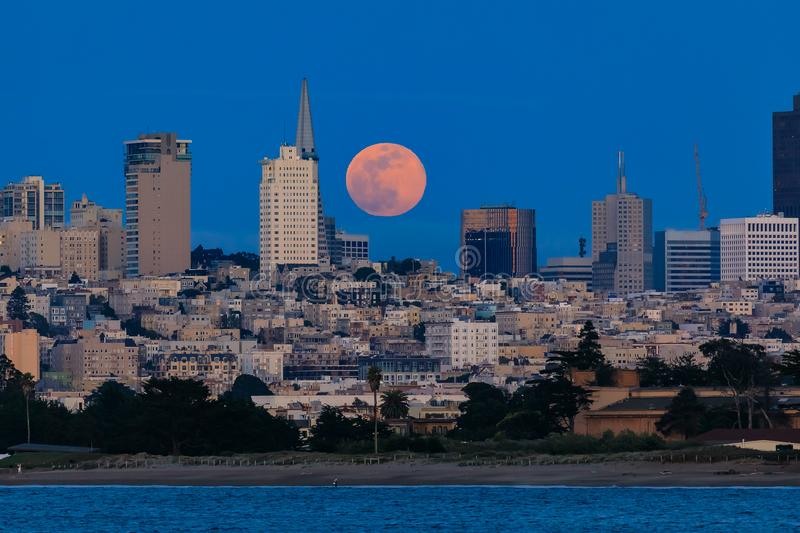 Panorama of moonrise above San Francisco Downtown viewed from Ma stock image