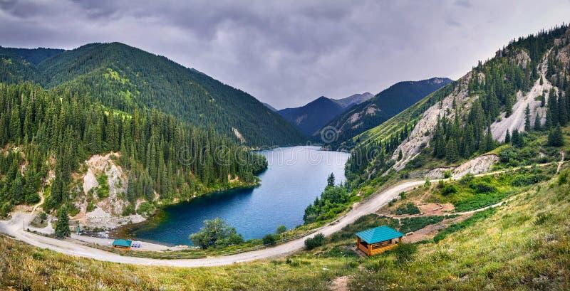 Beautiful scenic of Mountain Lake. Panorama of mountain Lake Kolsai in the mountains with fir forest in Kazakhstan royalty free stock photos