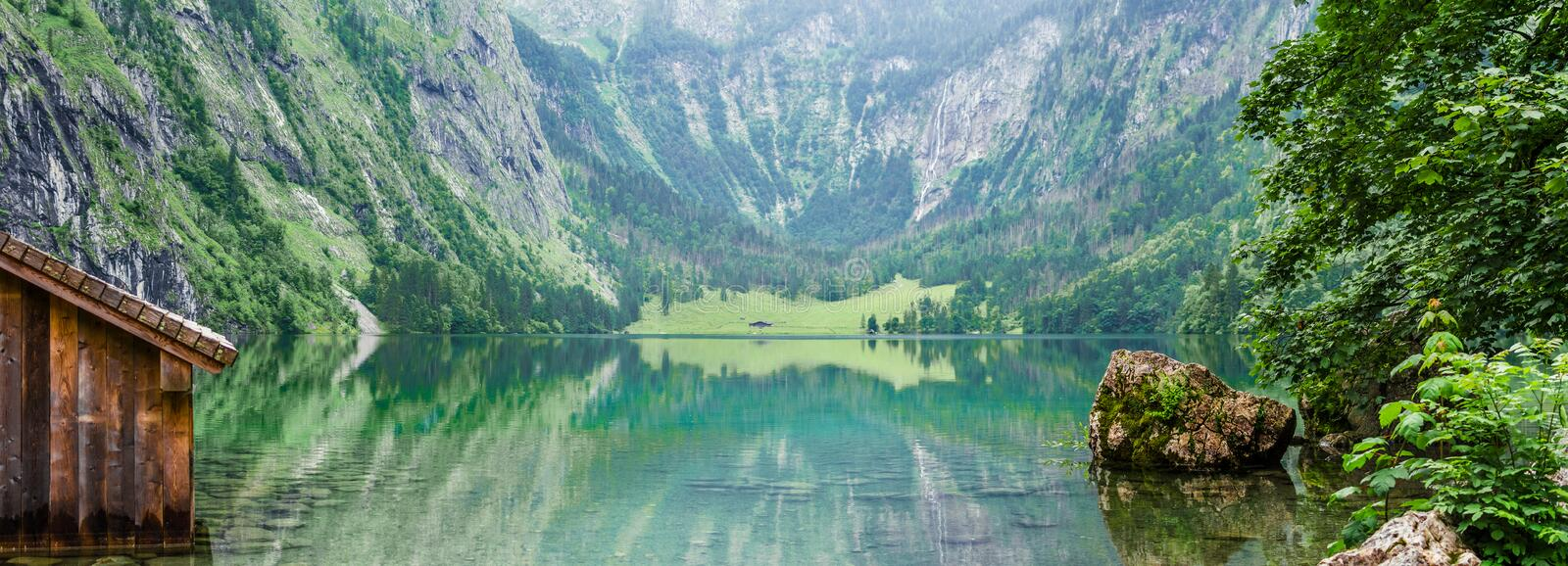 Panorama of mountain lake Obersee in German Alps. Bavaria, Germany. royalty free stock photo