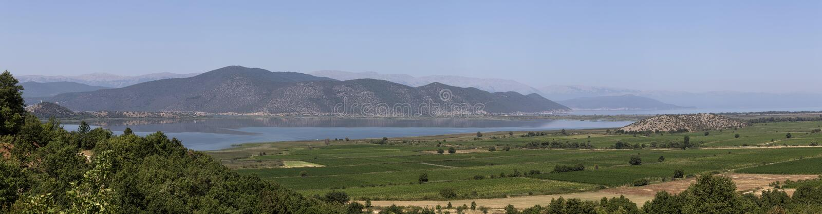Panorama of a mountain lake royalty free stock photo