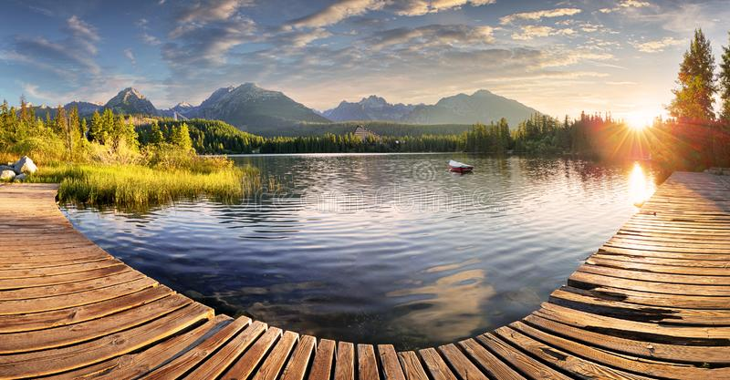 Panorama of Mountain lake Strbske pleso in National Park High Tatra, Slovakia, Europe at sunrise royalty free stock photos
