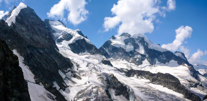 Panorama mountain landscape of the Bernina mountain range in Switzerland on a gorgeous summer day stock photos