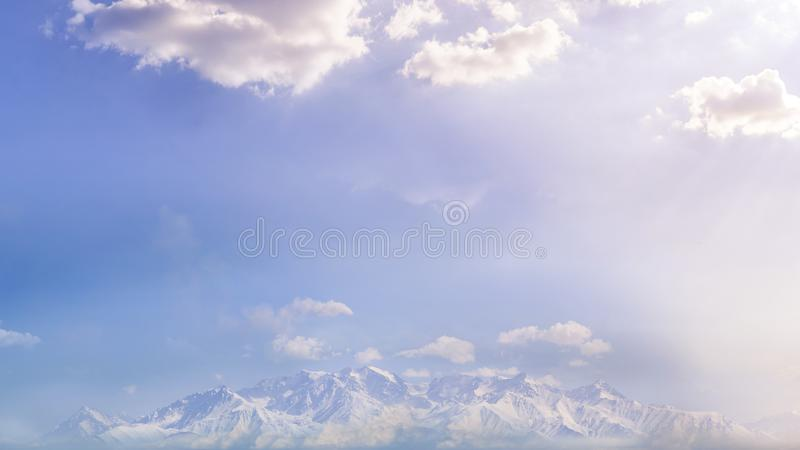 Panorama of mountain peaks, in a haze of clouds, from a bird`s eye view royalty free stock images