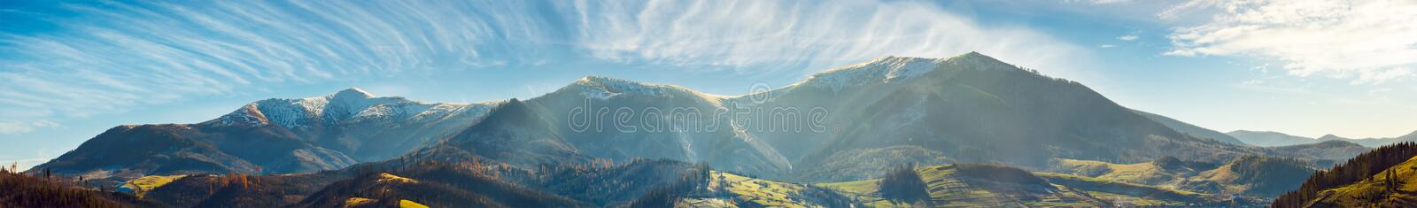 Panorama of mountain ridge with snowy tops stock images