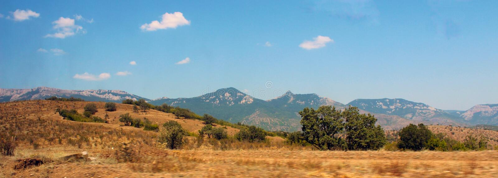 Panorama of mountains and sky stock photography