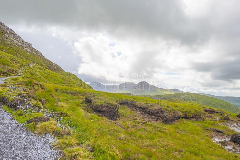 Panorama of mountains, marshy land and heathland of Connemara National Park in summer royalty free stock photography