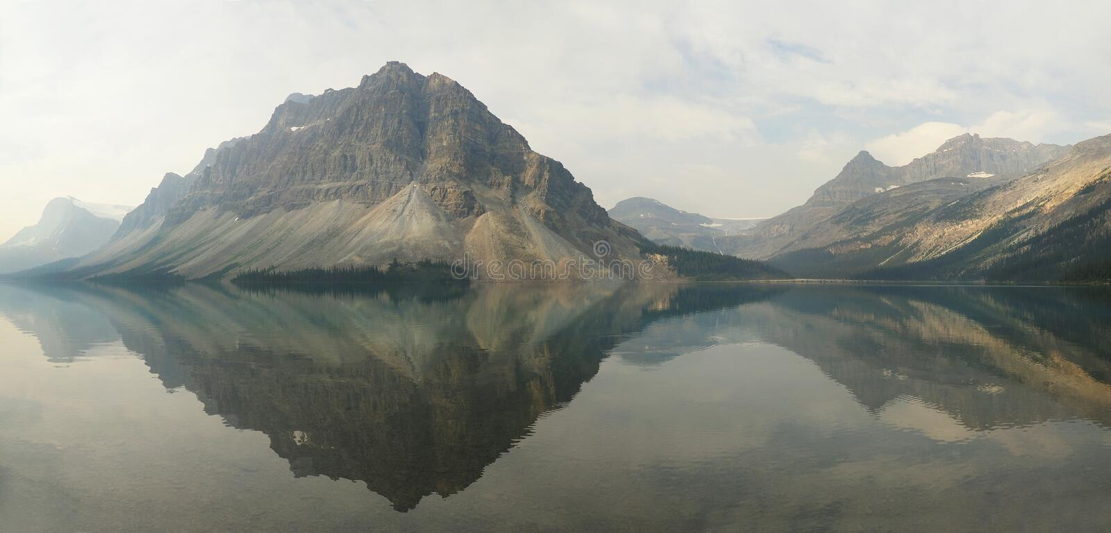Panorama of the Mountains Reflected in Bow Lake Alberta, Canada royalty free stock images