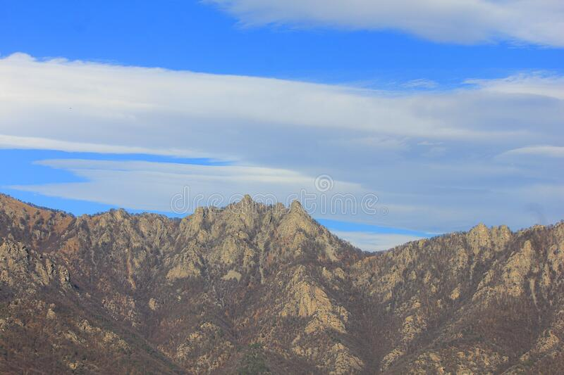 Panorama of mountains in winter without snow royalty free stock photo