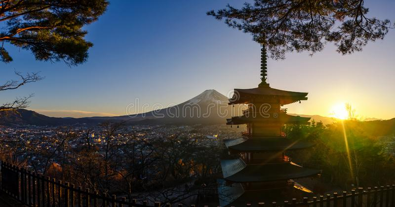 Panorama of mt. Fuji and silhouette Chureito Pagoda at sunset in the winter season. Located in Fujiyoshida, Japan. Panorama of mt. Fuji and silhouette Chureito stock photos