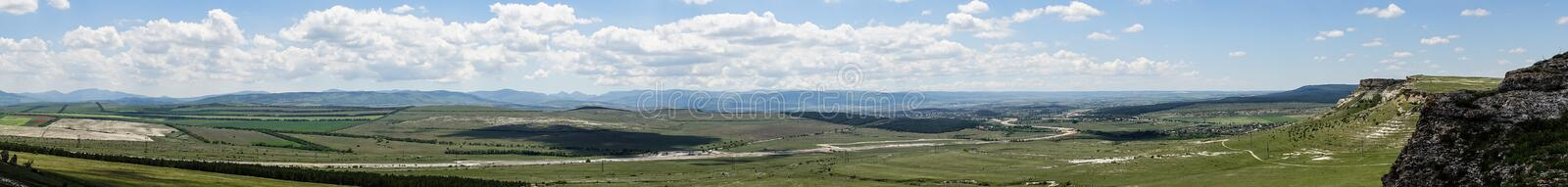 Panorama of natural landscape with mountains and valleys. Panorama of the natural landscape with mountains and valleys in the Crimea stock photo