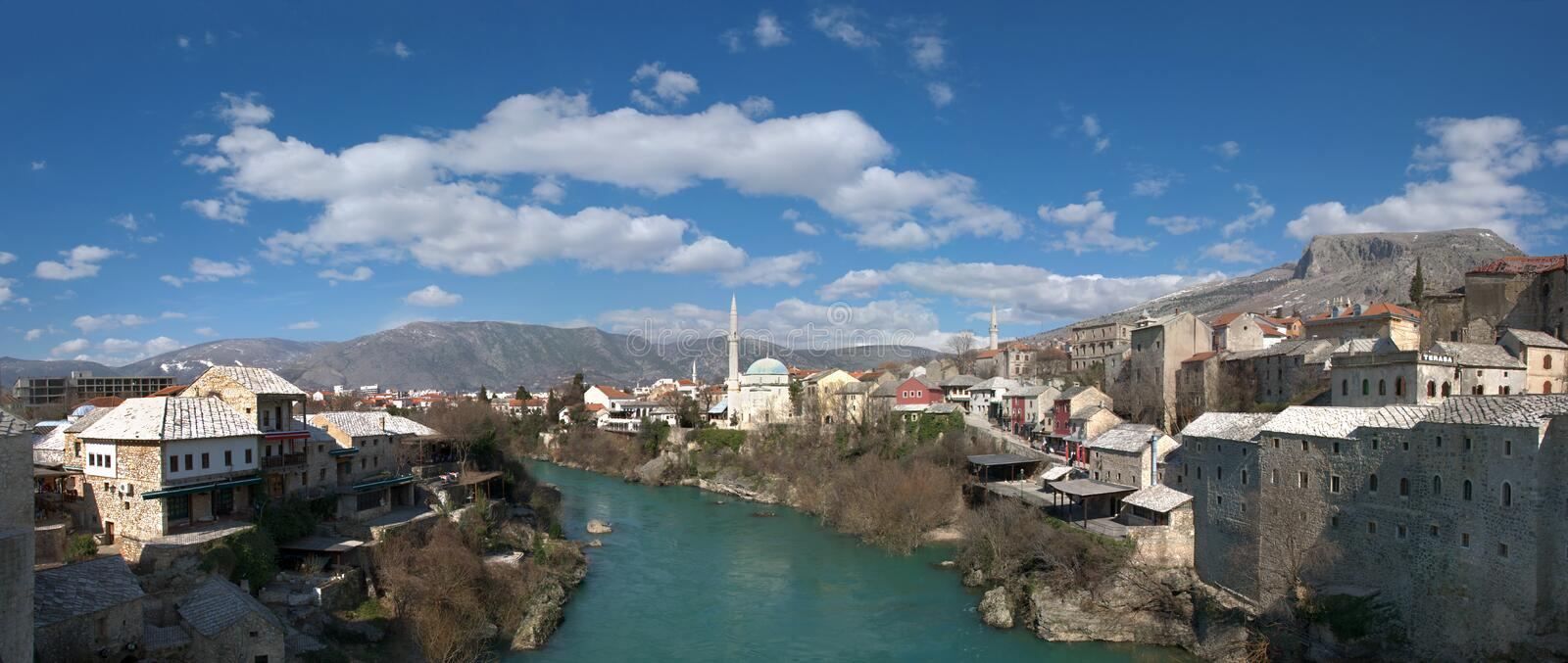 Panorama of Neretva River in Mostar Old Town. On a sunny winter day royalty free stock photo