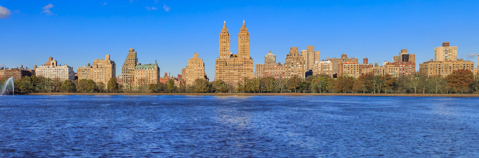 Panorama of New York Manhattan Upper west side skyline across the Jacqueline Kennedy Onassis Reservoir in Central Park. Panoramic View of New York Manhattan stock photos