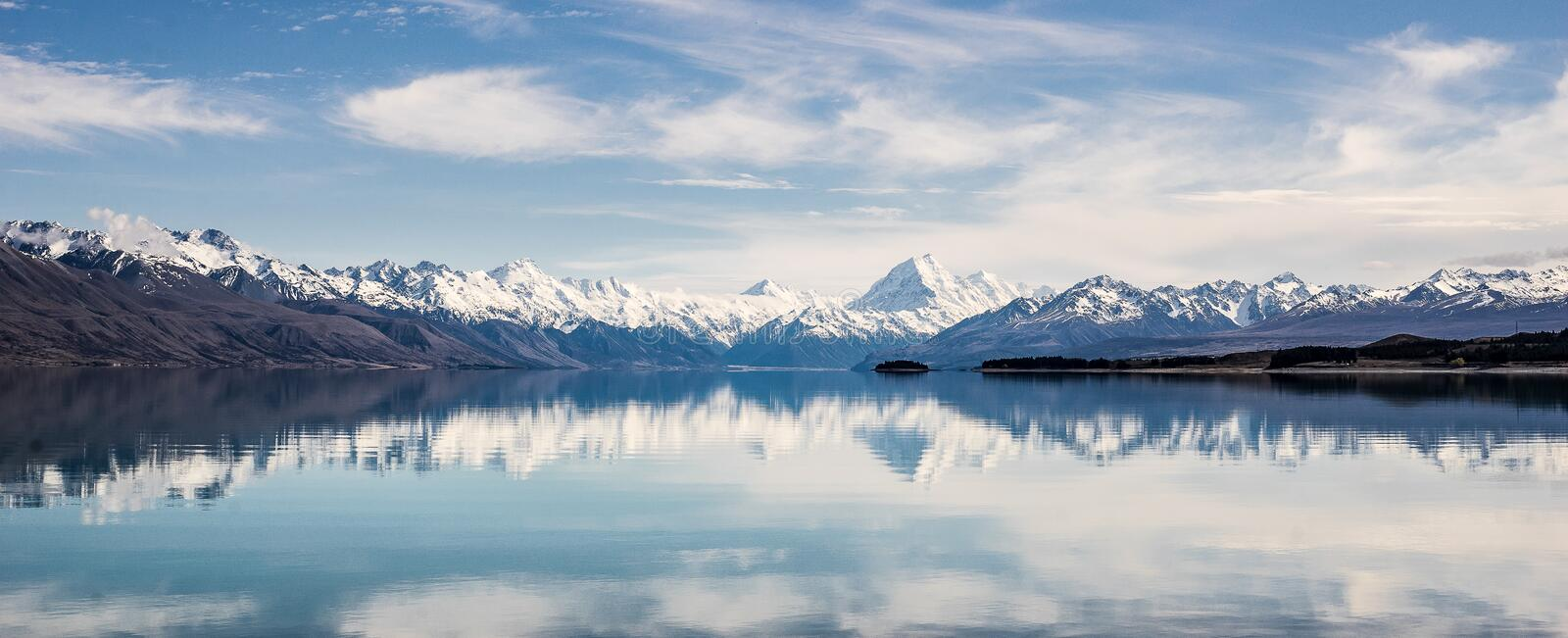 Panorama of New Zealand snow mountain reflect on turquoise lake stock photo