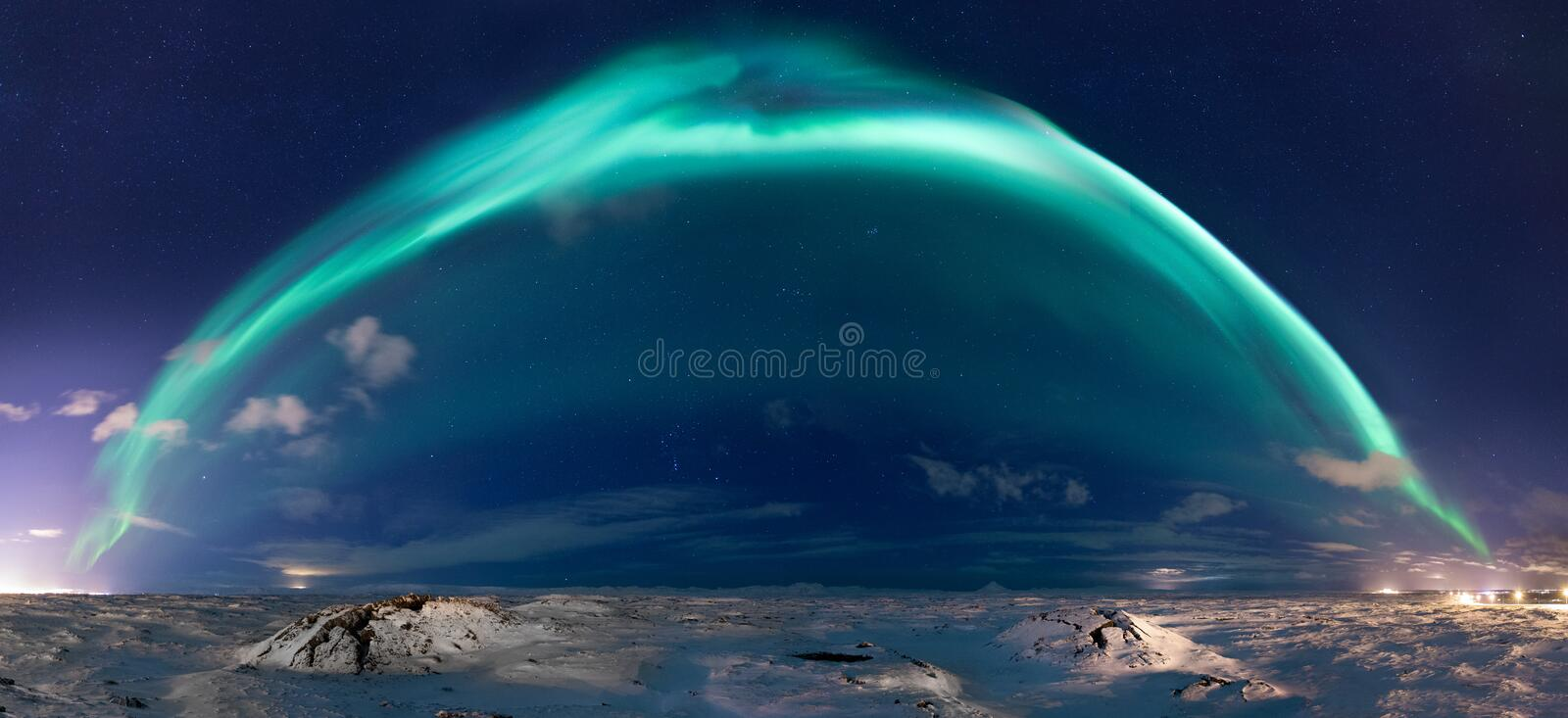 Panorama of northern lights. Northern lights stretching from the city of Reykjavik, Iceland to the west (left) to the town of Keflavik to the east (right royalty free stock photo