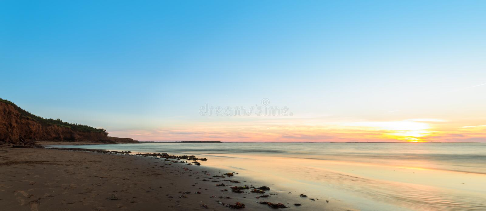 Panorama of ocean beach at sunset royalty free stock photo