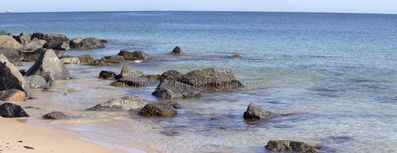Panorama of the Ocean Splashing on the Rocks