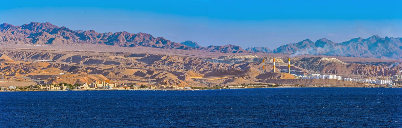 Panorama of oil refinery on Red Sea rocky coast. Panorama of oil refinery by frontier with Saudi Arabia, Aqaba, Jordan royalty free stock photo