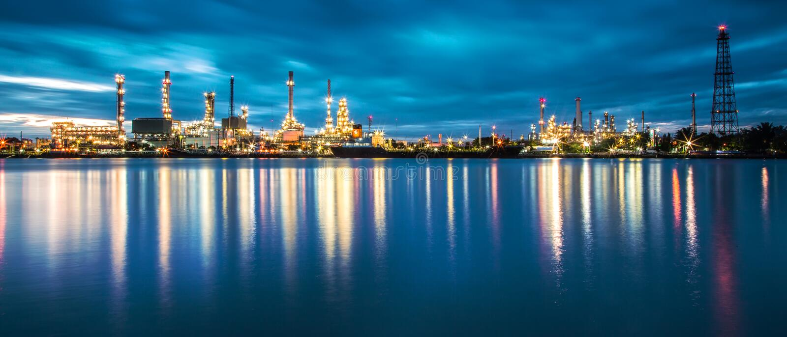 Panorama of Oil refinery with reflection royalty free stock photography