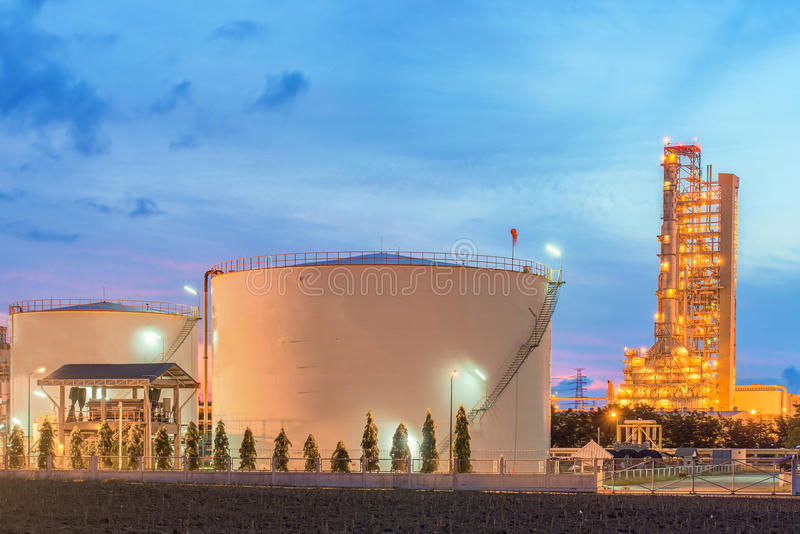 Panorama of Oil refinery and storage tanks at twilight.  stock photo