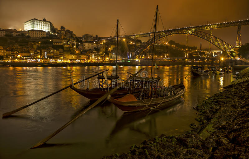 Panorama old Porto river Duoro, vintage port transporting boats, old town, town of Gaia and famous bridge Ponte dom Luis, Portugal stock image