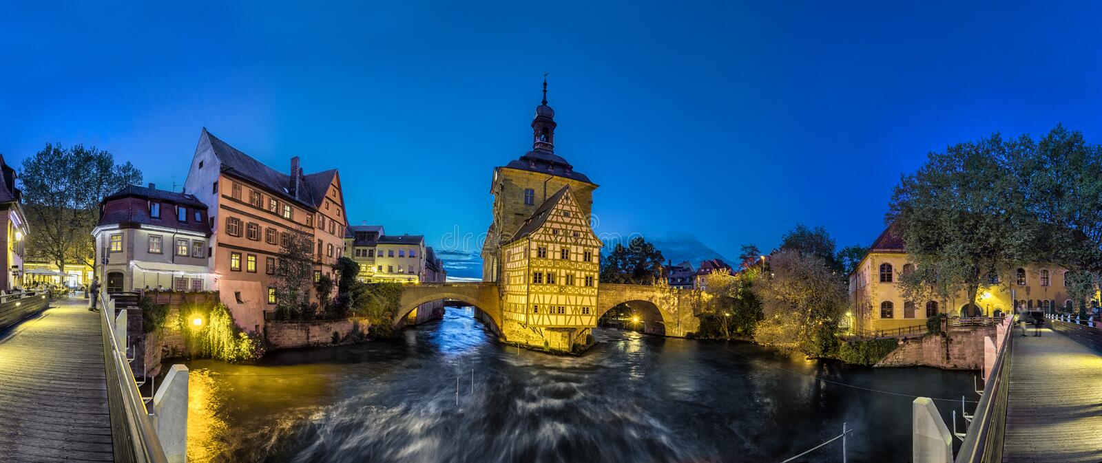 Panorama of Old Town Hall of Bamberg, Germany. Bamberg. Panoramic view of Old Town Hall of Bamberg Altes Rathaus with two bridges over the Regnitz river in the stock photography