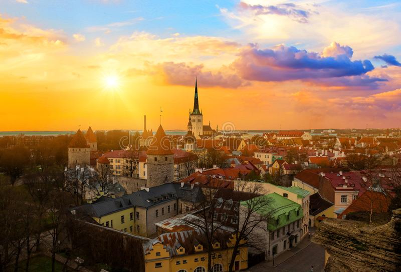 Panorama of old town of Tallinn, Etonia. Tallinn city wall and a view of the Church of St. Olaf. The skyline of the old town, suns royalty free stock images