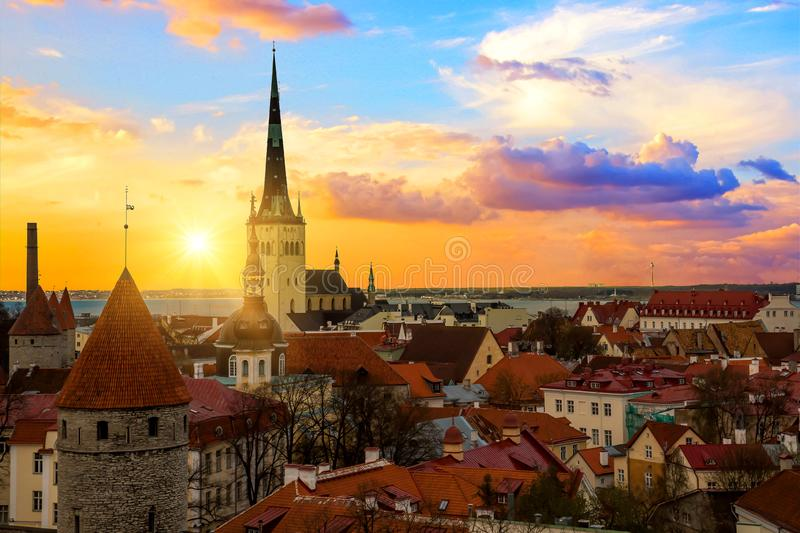 Panorama of old town of Tallinn, Etonia. Tallinn city wall and a view of the Church of St. Olaf. The skyline of the old town, suns royalty free stock photos