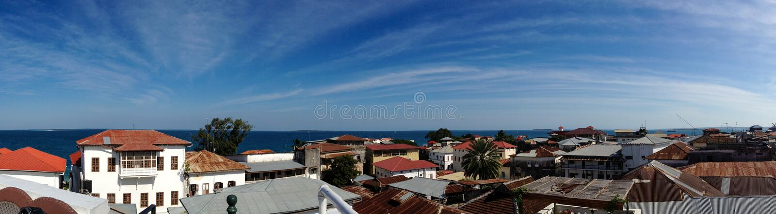 Panorama Over Rooftops. Panorama showing the view over the roof tops of Stone Town, Zanzibar stock photo