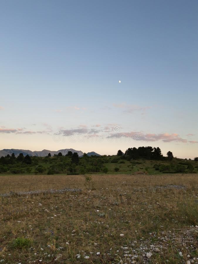 Panorama of Ovindoli& x27;s meadows, with sky at sunset and mountains on the background. Ovindolis stock photography