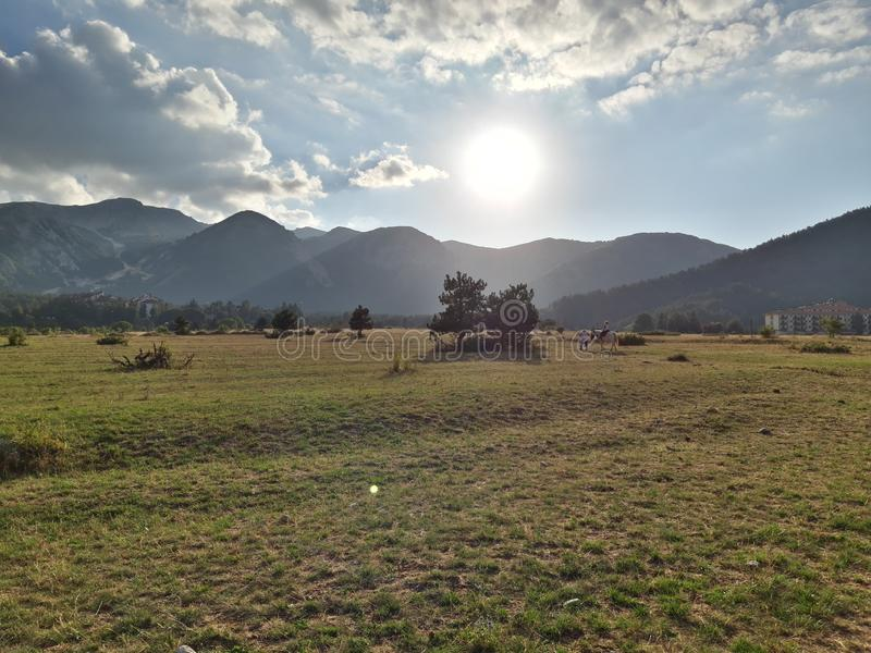 Panorama of Ovindoli& x27;s meadows, with sky at sunset and mountains on the background. Ovindolis stock image