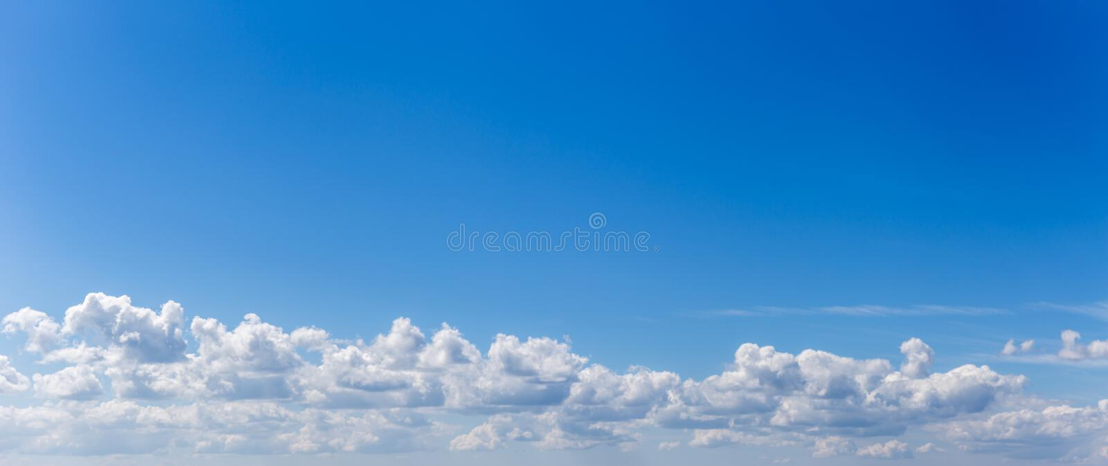 Panorama or panoramic photo of blue sky and clouds or cloudscape. stock photo