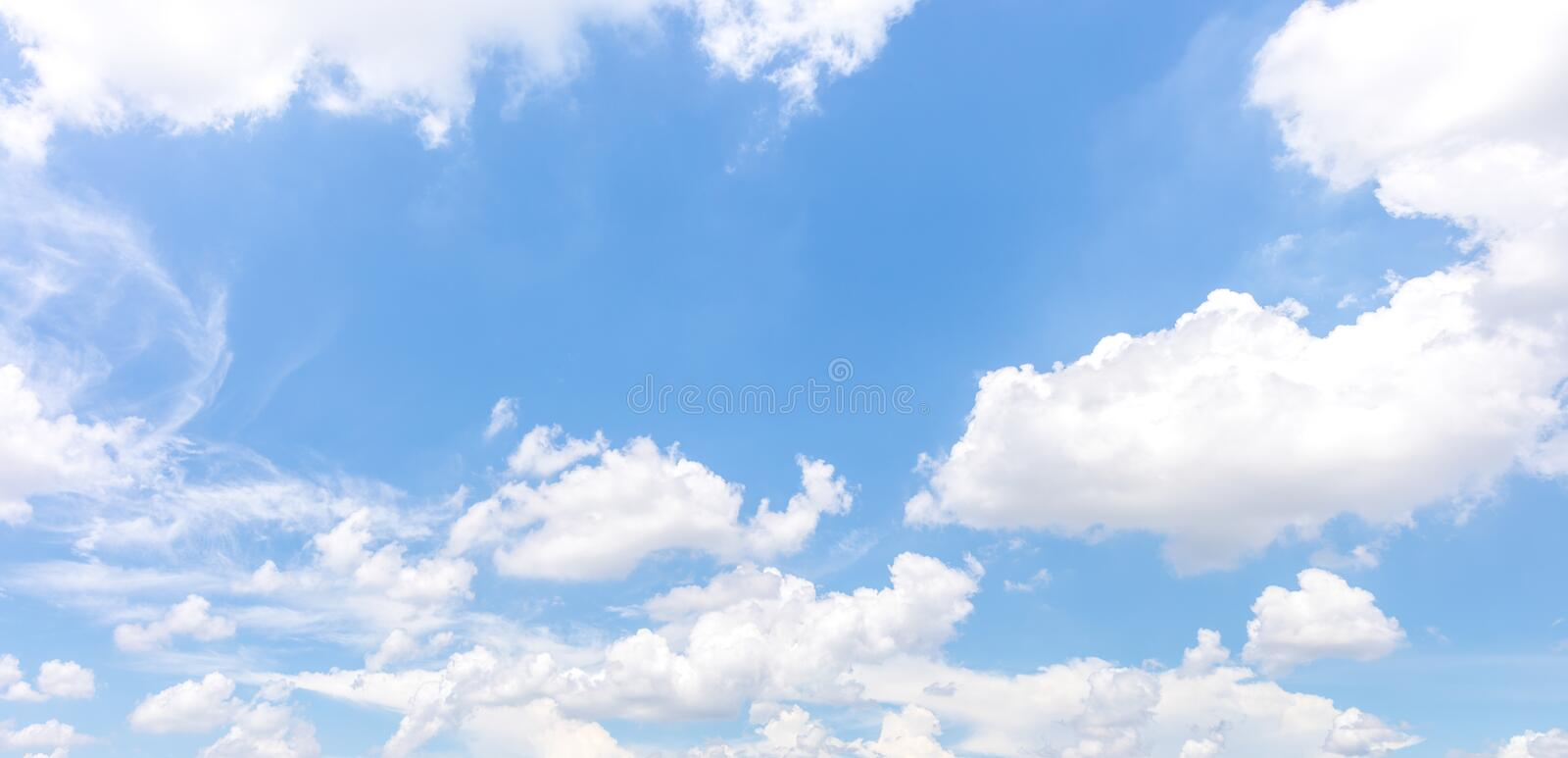 Panorama or panoramic photo of blue sky and white clouds or cloudscape. royalty free stock photos