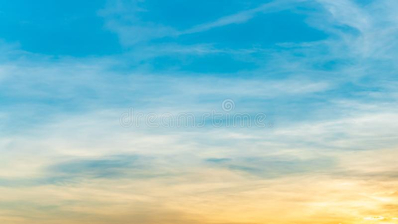 Panorama or panoramic photo of blue sky and white clouds or cloudscape at sunset time royalty free stock photography