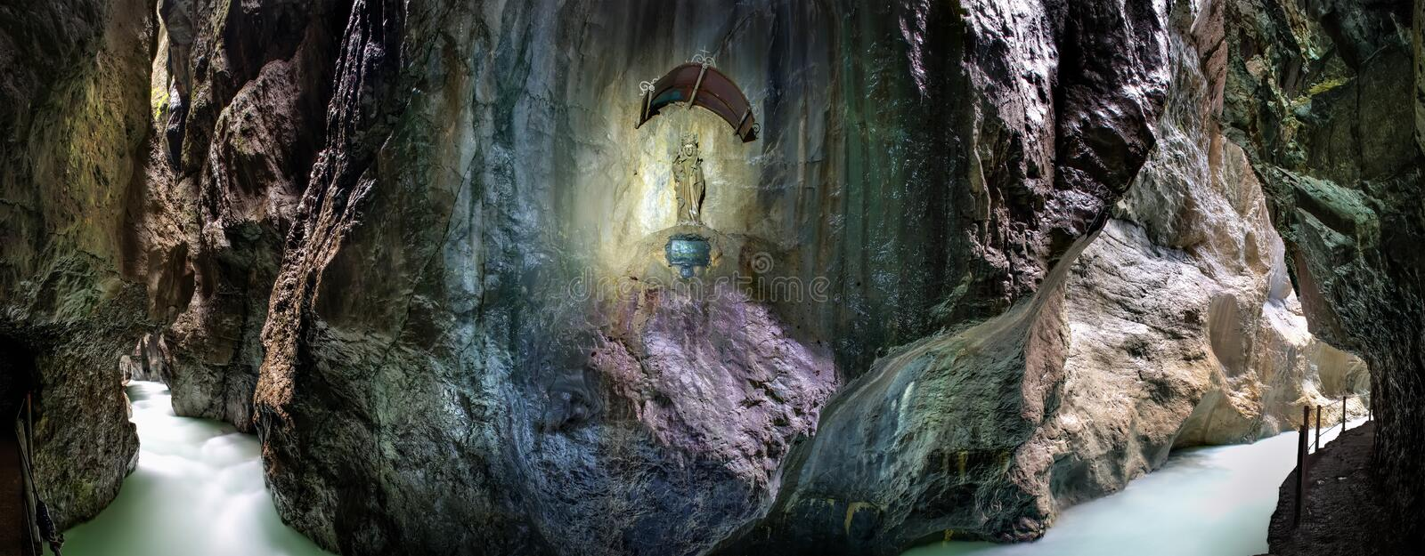 Panorama Partnachklamm. Panorama image of river Partnachklamm with Maria statue in Garmisch-Partenkirchen, Germany royalty free stock photo