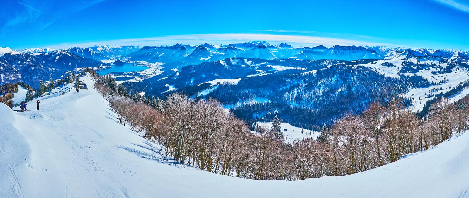 Panorama from the peak of Zwolferhorn, St Gilden, Salzkammergut, Austria. Panorama from Zwolferhorn mountain top with a view on Alpine scenery, pine forests stock photos
