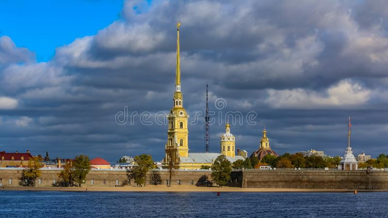 Panorama of the Peter and Paul Fortress in Saint Petersburg with the Neva river. Panoramic view of the Peter and Paul Fortress with the Neva river in the royalty free stock photo