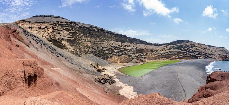 Panorama photo of the green lake, El Lago Verde, Lanzarote, Spain stock photos