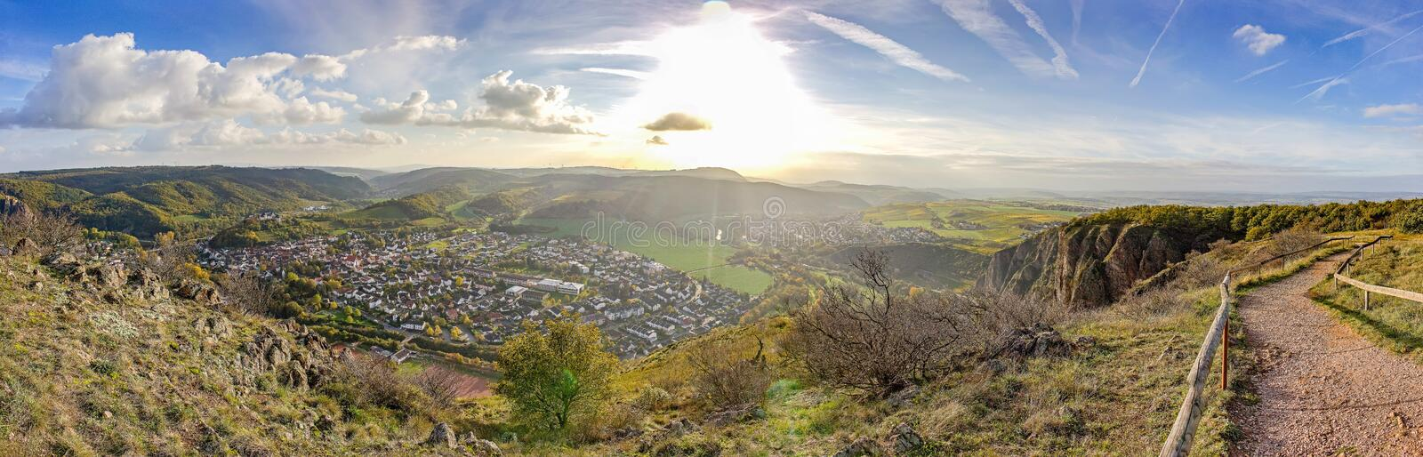 Panorama photo of the setting sun from mountaintop in Bad Münster am Stein, Germany - small. Panorama photo of the setting sun from mountaintop in Bad Mü royalty free stock photography