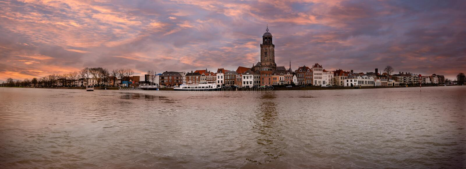 Panorama photo taken in winter of the Hanseatic city of Devente. R on the other side of the river IJssel, with beautiful colored cloudy skies stock photos