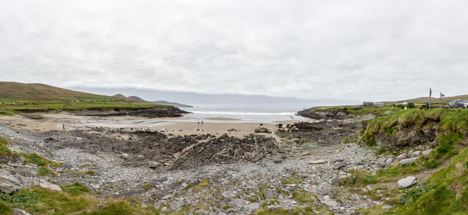 Panorama picture of St. Finian´s Beach in southern west Ireland. During daytime and stormy weather royalty free stock photos