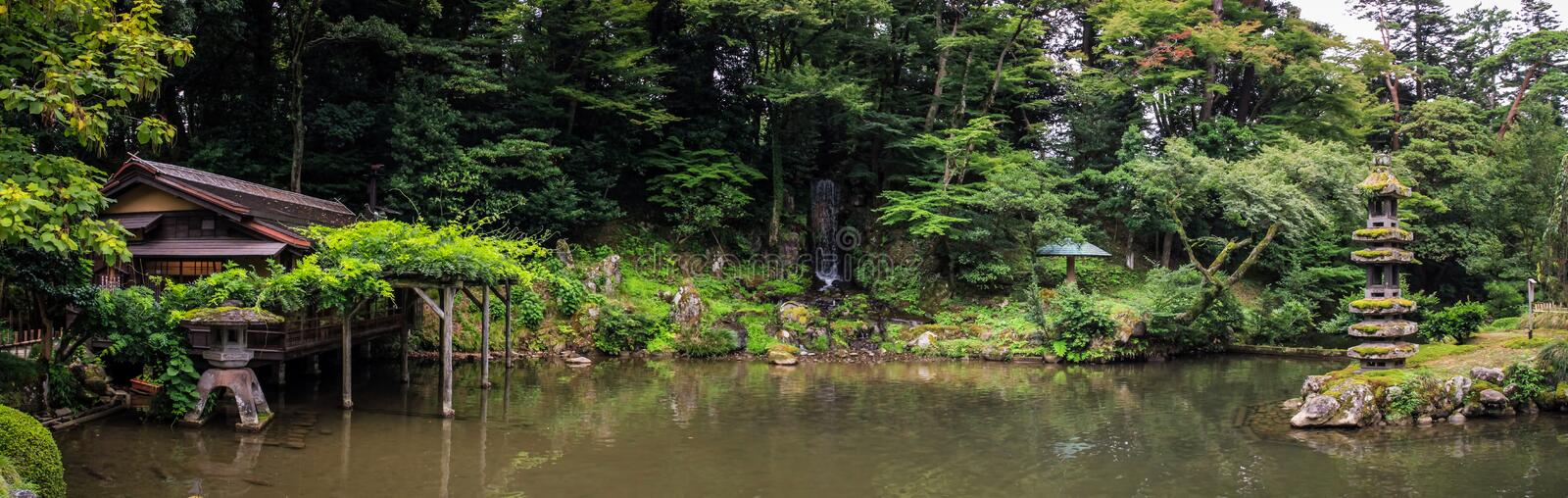 Panorama of the picturesque Kenroku-en gardens, Kanazawa, Ishikawa, Japan. Kenroku-en located in Kanazawa, Ishikawa, Japan, is an old private garden. Along with royalty free stock images