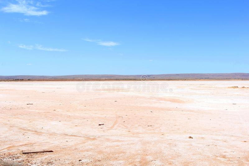 Panorama of a pink salt lake in the desert, Australian Outback. Pink salt lake in the desert around Pimba, along the Stuart Highway, Outback of South Australia stock photo