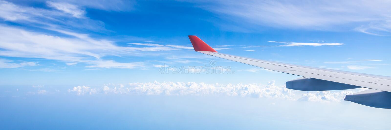 Panorama of plane wing above nice blue sky royalty free stock photos