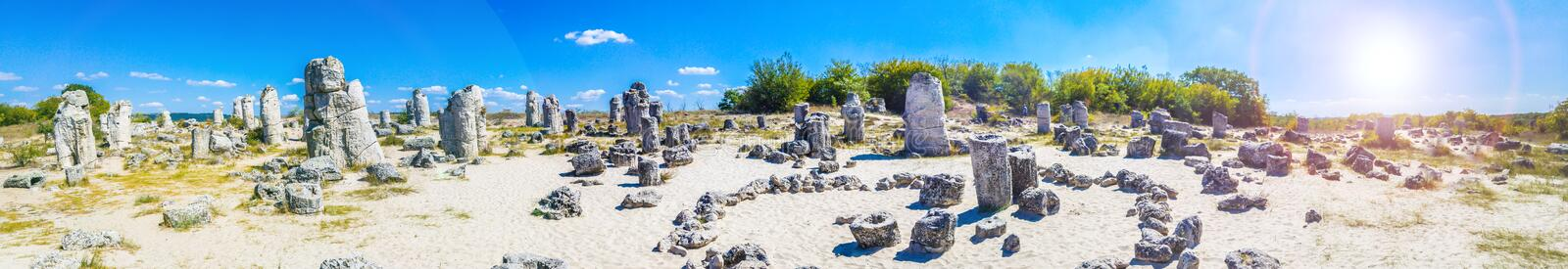Panorama of Pobiti Kamani, Bulgaria. Pobiti Kamani Bulgarian, `planted stones`, also known as The Stone Desert, is a desert-like rock phenomenon located on the royalty free stock photo