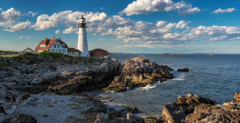 Panorama of Portland Head Light at sunset in Cape Elizabeth, Maine, USA. Portland Lighthouse at sunset in Cape Elizabeth, Maine, USA. One of the most Iconic and stock photo