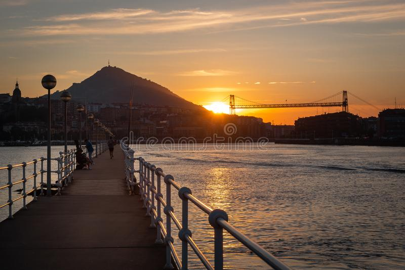 Panorama of Portugalete and Getxo with Hanging Bridge of Bizkaia at sunset, Basque Country, Spain. Panorama of Portugalete and Getxo with Hanging Bridge of stock images