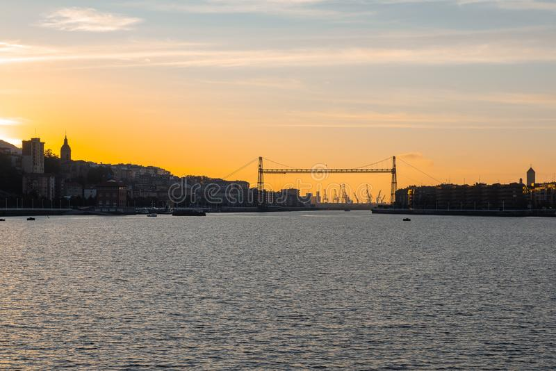 Panorama of Portugalete and Getxo with Hanging Bridge of Bizkaia at sunset, Basque Country, Spain. Panorama of Portugalete and Getxo with Hanging Bridge of royalty free stock photography