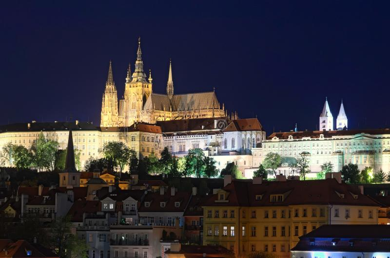 Panorama of Prague Castle with Saint Vitus Cathedral and other ancient buildings at summer night. Prague, Czech Republic royalty free stock photography