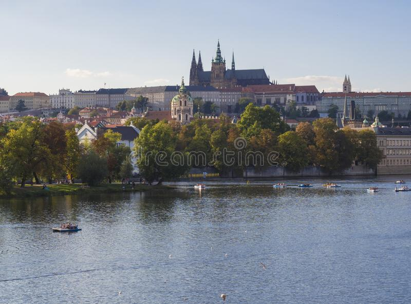 Panorama of Prague Castle and St. Vitus Cathedral over Vltava river and Gradchany, Czech Republic, golden hour light, summer sunny stock image