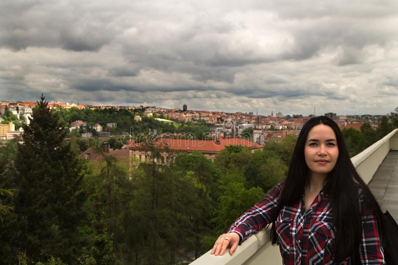 Panorama of Prague. Portrait of young brunette woman. stock photo